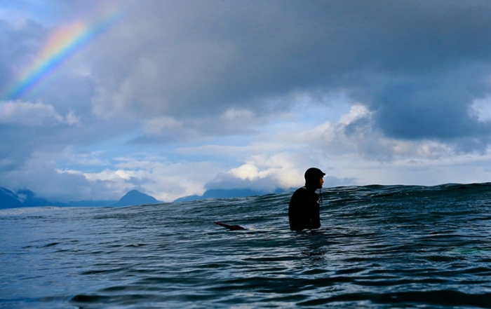 winter-surfing-pacific-surf-company-surfer-waiting-tofino-vancouver-island-british-columbia-canada